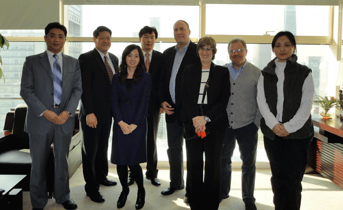 Ai Squared CEO  with representatives from Hand in Hand, ATIA, Perkins, and Tsinghua University
