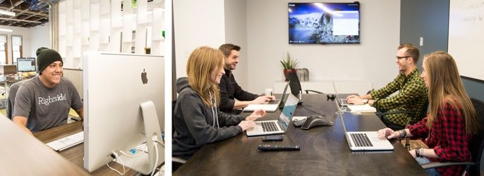 Engineer sits at an iMac while team members meet in a conference room