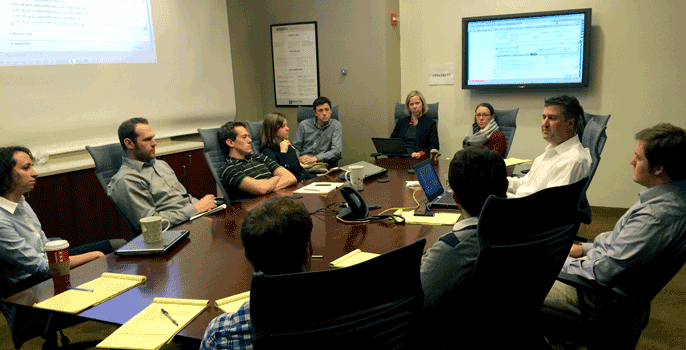 A Brafton content marketing team meets in a conference room