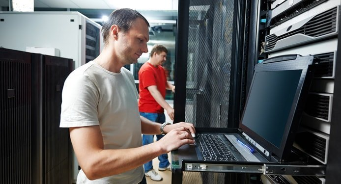 Image of technical support staff working in a datacenter