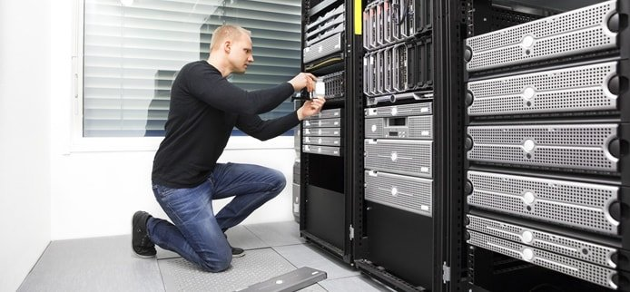 Image of an IT expert working on a server