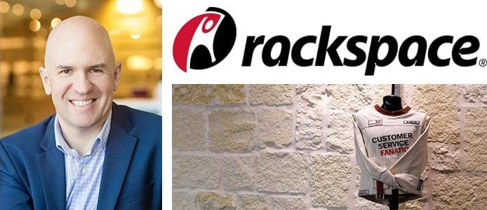 Rackspace CTO John Engates with Rackspace logo and image of a straight jacket awarded to those who make major contributions to the company