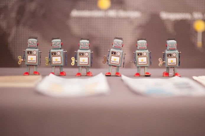 Photo of a team of windup robots with FastComet logos on their chasis