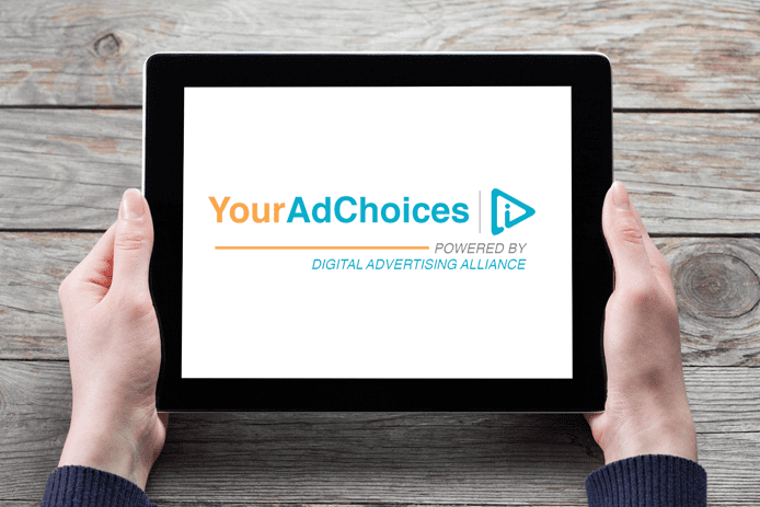 Photo of a tablet with the YourAdChoices logo on the screen