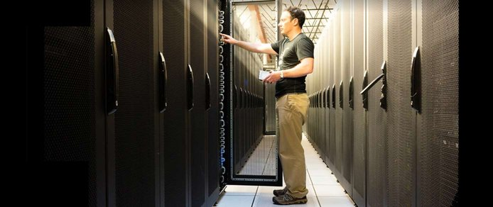Image of a person working at a datacenter