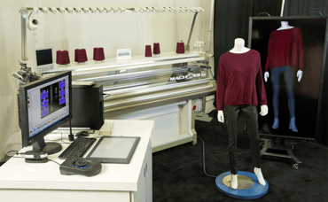 Photo of Shima Seiki's 3D knitting machine in the Intel booth