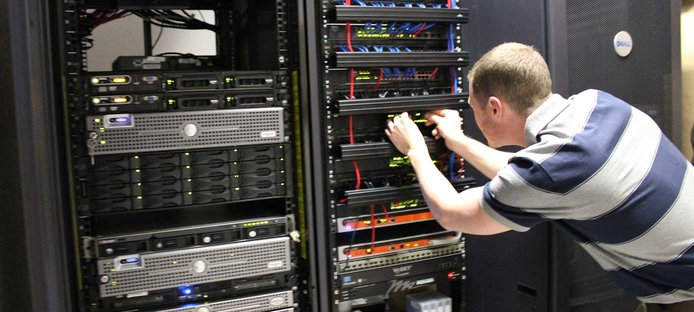 Image of a man working on a server