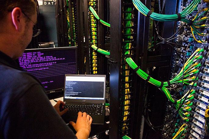 DreamHost developer working on a datacenter