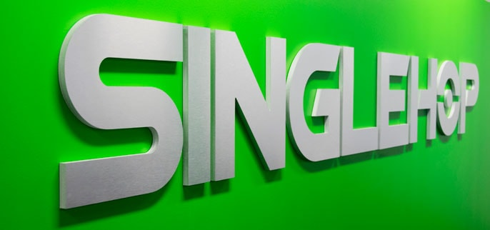 SingleHop's logo on a bright green wall