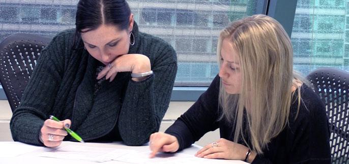 SingleHop employees discuss paperwork
