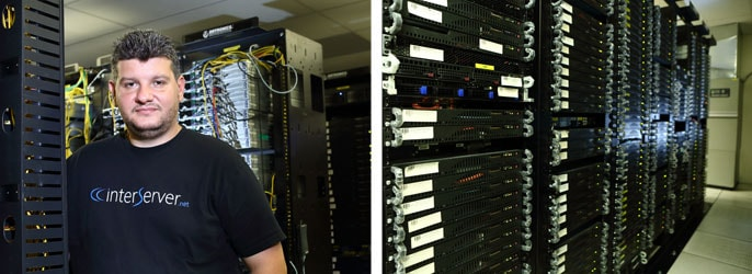 Mike poses in the datacenter he designed and built out