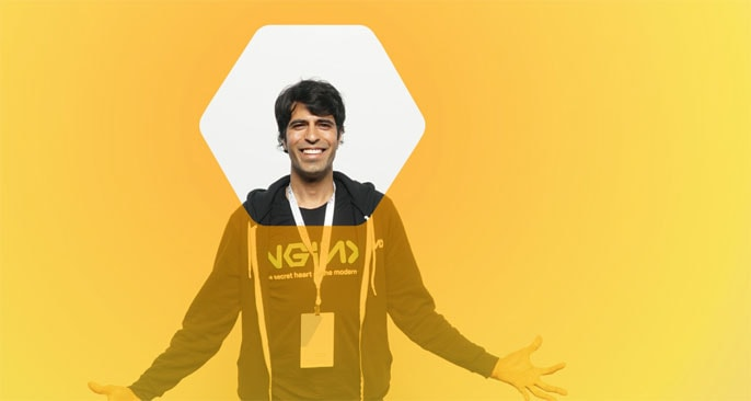 Faisal Memon, NGINX Technical Product Marketing Manager, stands behind a yellow screen