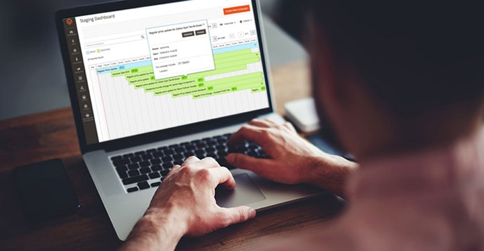 Mockup of a person working on Magento on a laptop