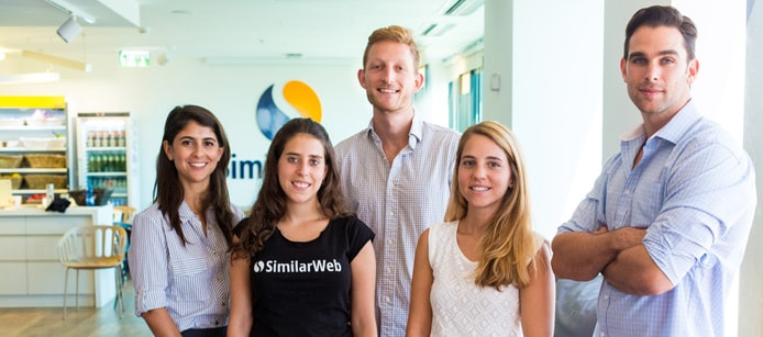 Five SimilarWeb employees in the office
