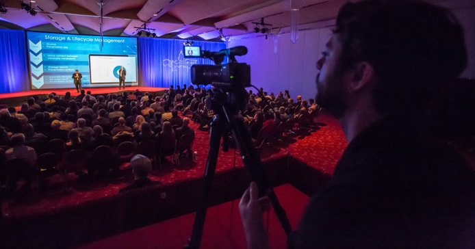 Photo of Sonic Foundry videographer recording conference proceedings