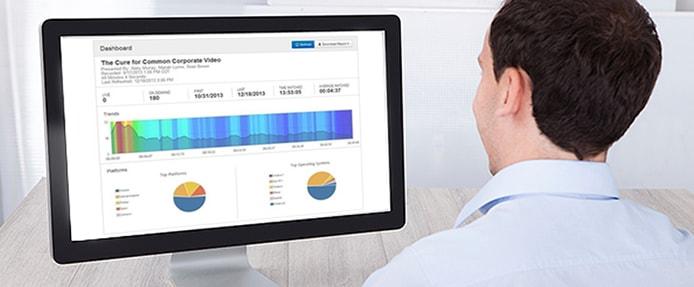 Photo of a man employing Mediasite analytics on a desktop computer