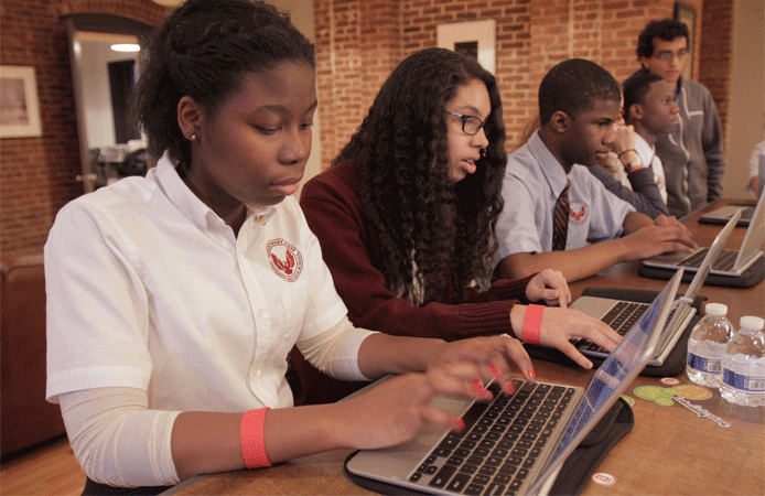 Photo of children practicing programming through Codecademy