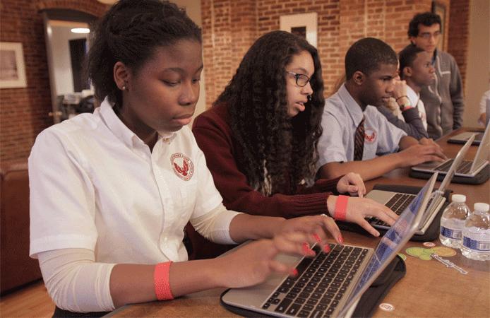 Photo of children practicing programming through Codecademy