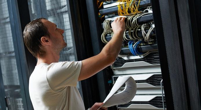 Image of engineer working on a server