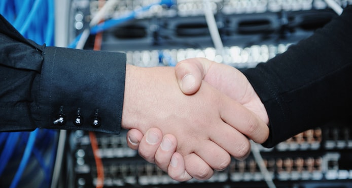 Handshake in front of servers