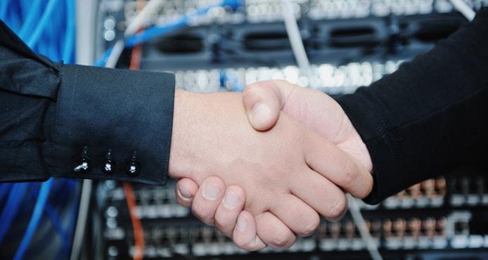 Handshake in front of servers