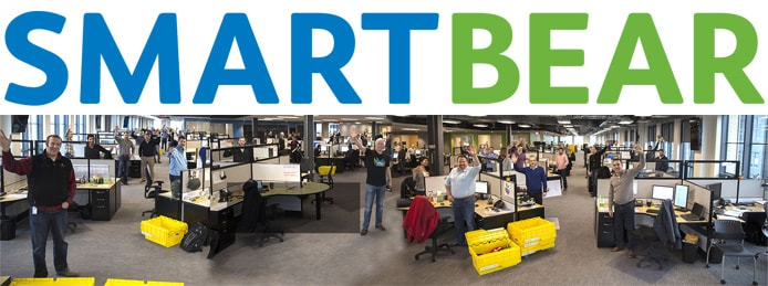 SmartBear logo with panoramic image of team and office