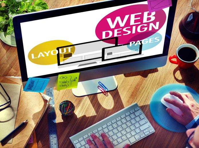 Depiction of someone at a desktop computer designing a website