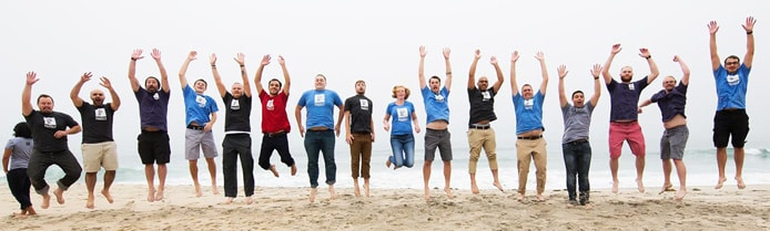 Image of Pagely team jumping on the beach