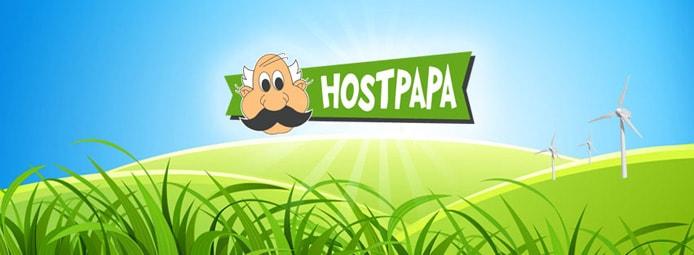 HostPapa logo above green hills with wind energy turbines