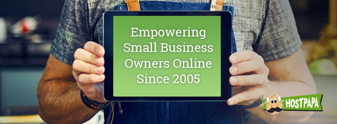 "Photo of a man holding a tablet with ""Empowering Small Business Owners Online Since 2005"" on the screen and the HostPapa logo"