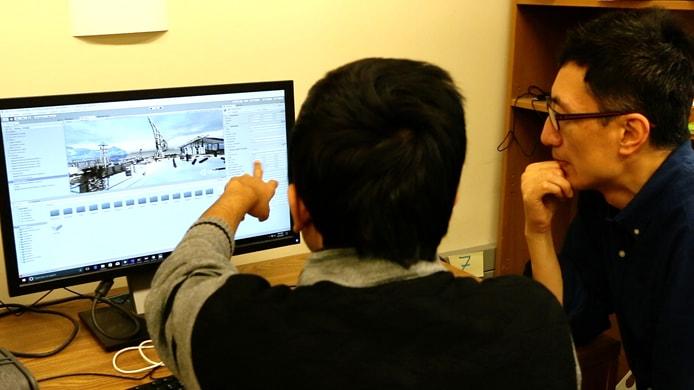 Charlie Hu and graduate student working on Furion