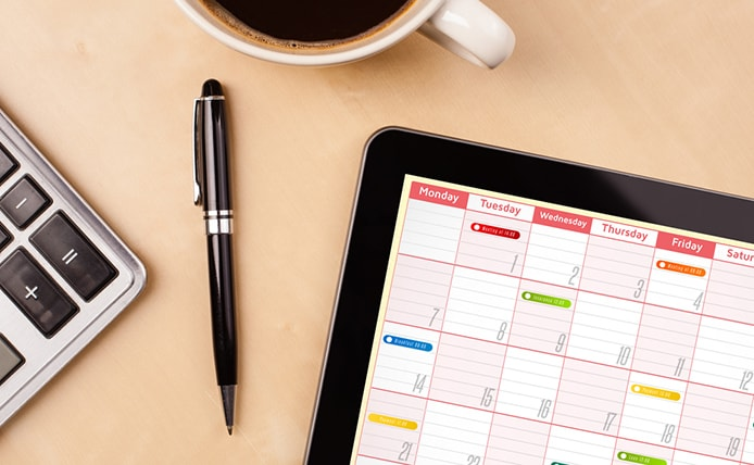 Image of calendar with calculator and coffee