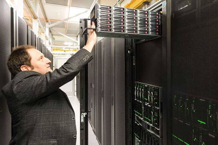 Photo of Eric Hulbert inspecting a server in Opus Interactive's Hillsboro datacenter