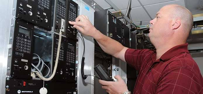 Image of a person working on a server