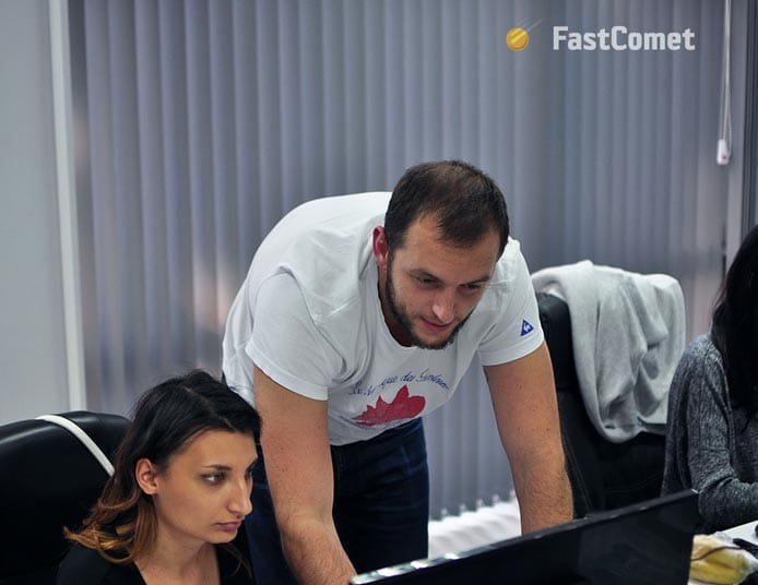 Photo of FastComet workers at an office
