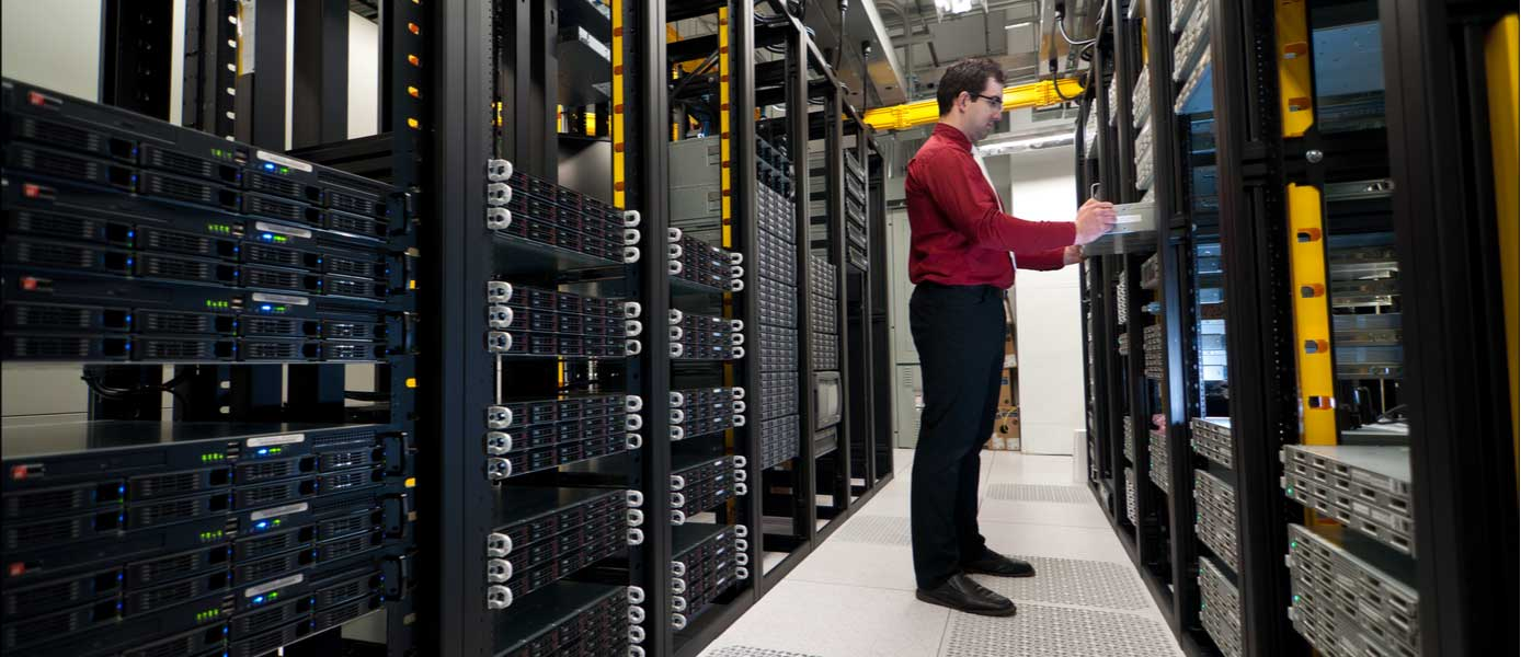 Image of server administrator working in a datacenter