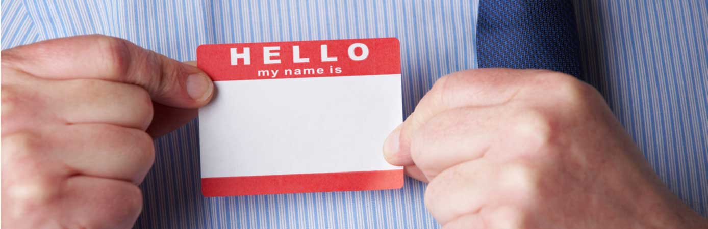 Man placing a name tag